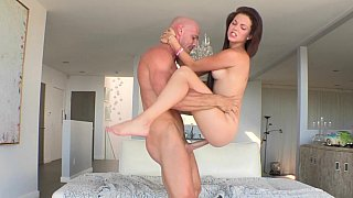 Skinny Kiera sliding on a big cock and taking facial