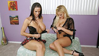 Two sexy bitches get oiled and ass fucked