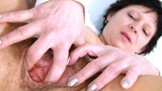 Sexy Milf in nurse uniform stretching hairy pussy