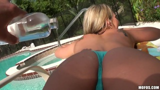 Hot neighbor babe, named Nikki, loves to tan topless in the backyard