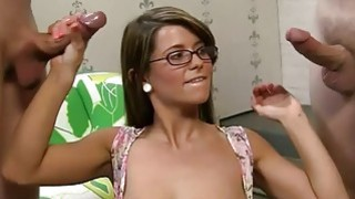 Sexy girl in glasses uses two dicks