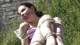 Outdoor bondage and cloth gagging of dominated sub