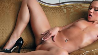 Cute brunette with small tits and tattoos is having solo