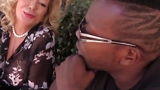 Chubby mature bitch in stockings is getting her pussy hammered by a loaded black piston